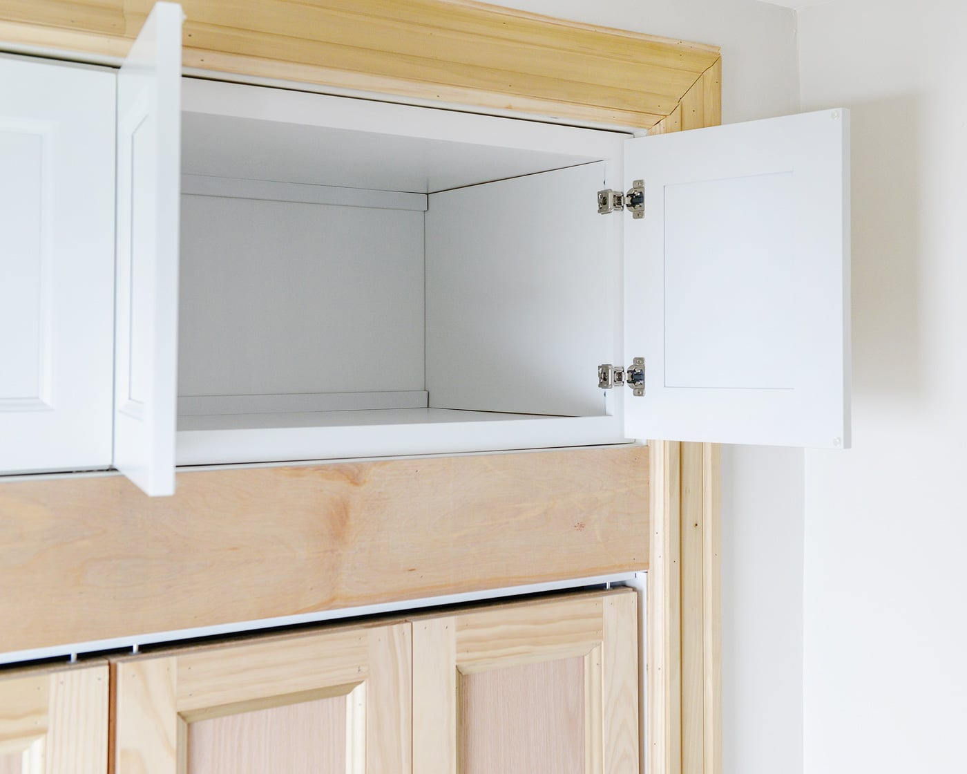 Adding extra deep cabinets above our closet for Extra closet storage