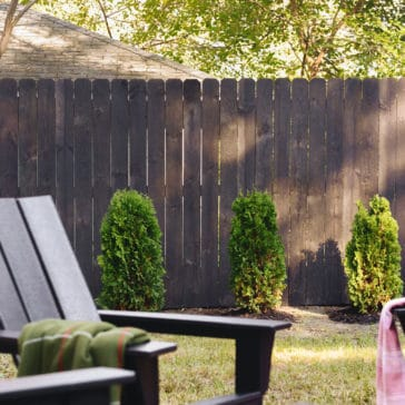 How we stained our fence black! via Yellow Brick Home