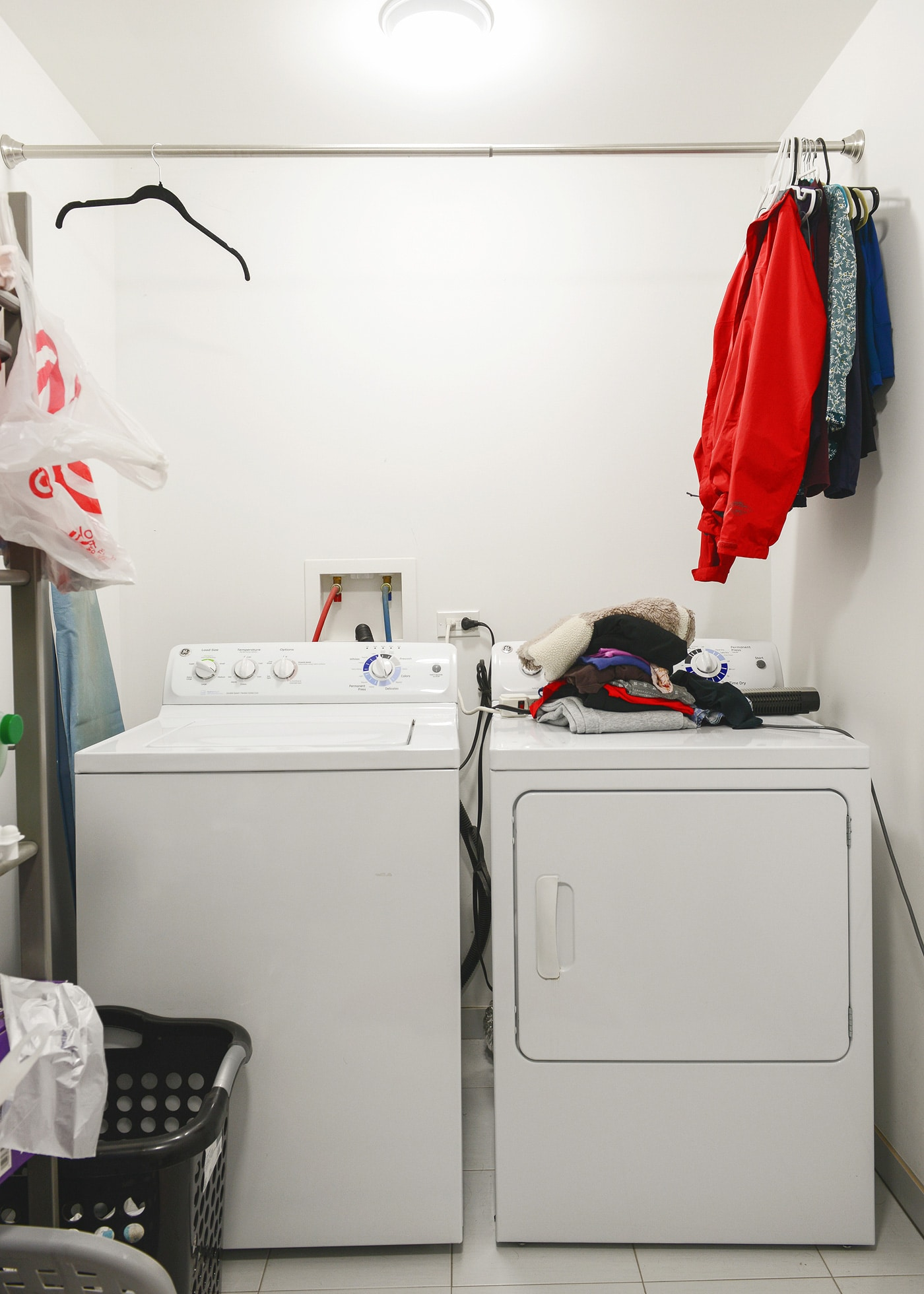 A 2 day laundry room makeover! Sherwin Williams Faint Coral walls and all items are from Lowe