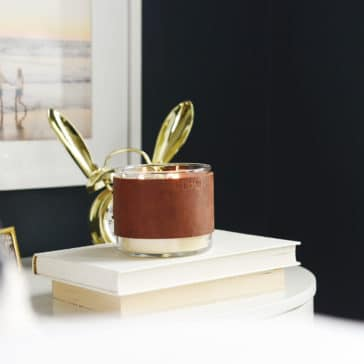 DIY leather candle cozy, leather candle wrap, rustic candle idea // via Yellow Brick Home