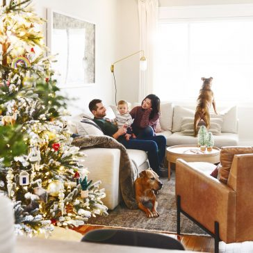 Merry Christmas! Happy Holidays! Neutral holiday living room with flocked Christmas tree // via Yellow Brick Home