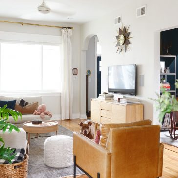 Neutral living room, light wood tones and leather, Benjamin Moore Intense White walls   via Yellow Brick Home