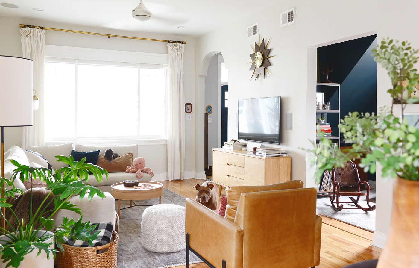 Neutral living room, light wood tones and leather, Benjamin Moore Intense White walls | via Yellow Brick Home