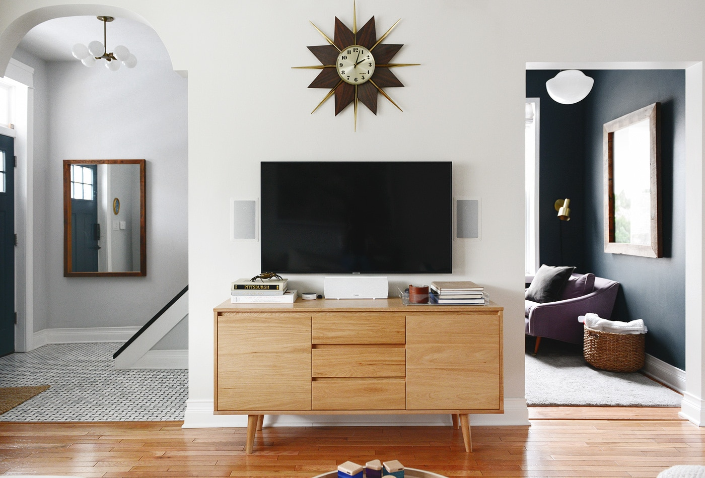Mid century media console in neutral living room // How to keep media console organized // via Yellow Brick Home