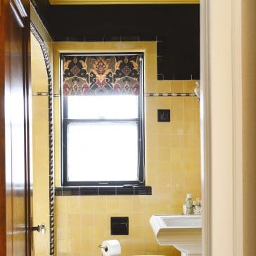 black and yellow vintage bathroom | Lowe's bathroom refresh | via Yellow Brick Home