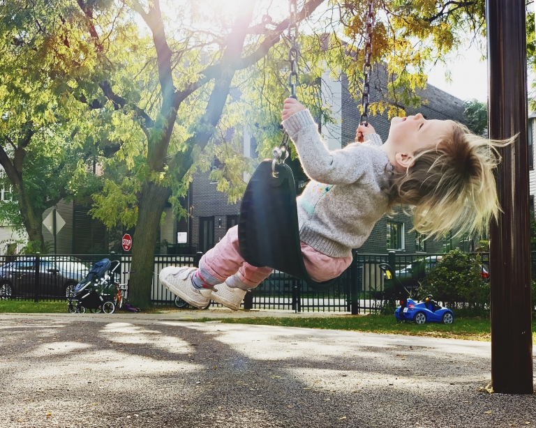 Lucy on the swing at the park | Lucy's toddler schedule at 22 months old | via Yellow Brick Home