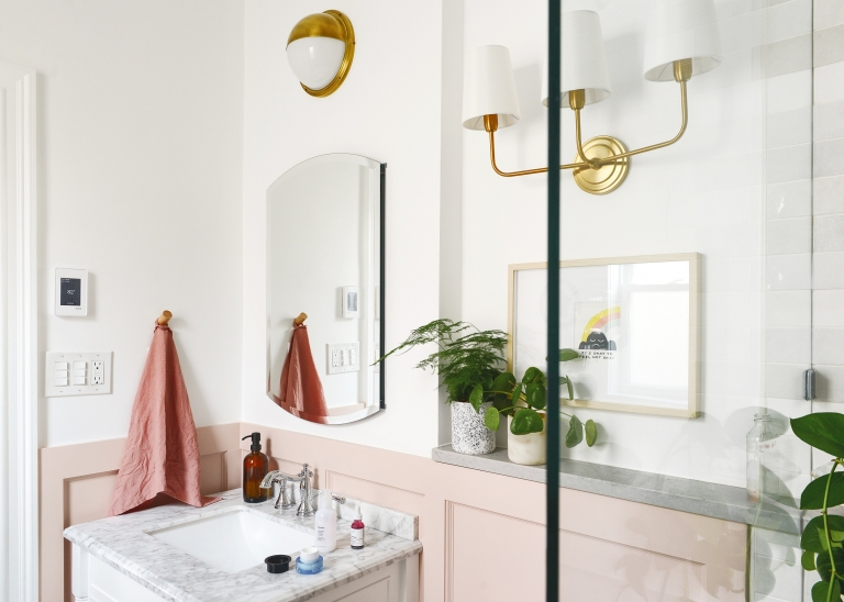 A white and pink bathroom with brass accents | The Weekender: My Skin care Routine, a Podcast to Love and Our Queen Anne Home - Yellow Brick Home